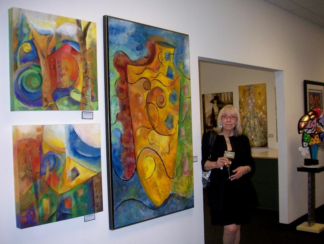 Artist standing next to her lastest work