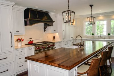 Farmhouse style with white cabinets and wood island countertop