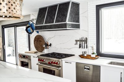 Transitional style kitchen design with white cabinets and black trim for Industrial vibe
