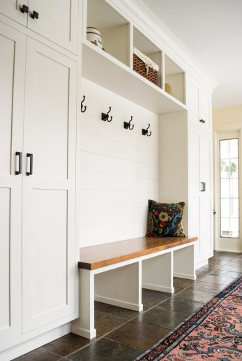 Mudroom white cabinets storage and walnut bench