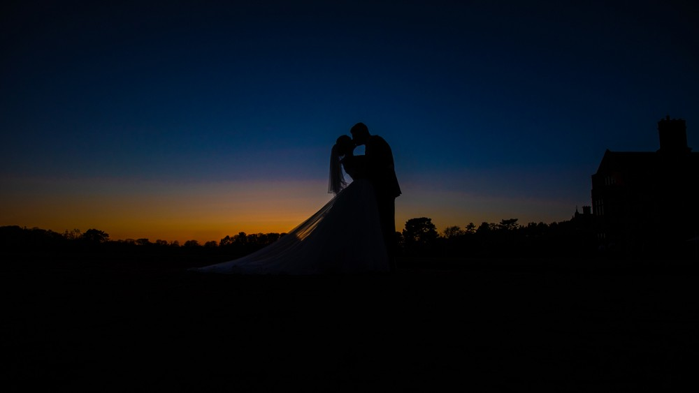 Bride and groom Silhouettet at sunset Thornton Manor
