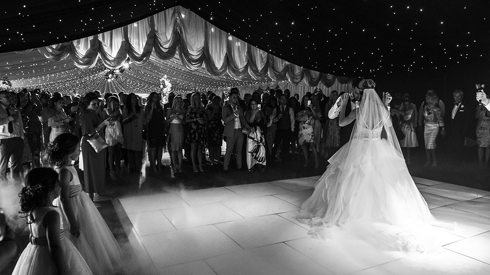 1st dance at wedding. reveal in lakeside marquee