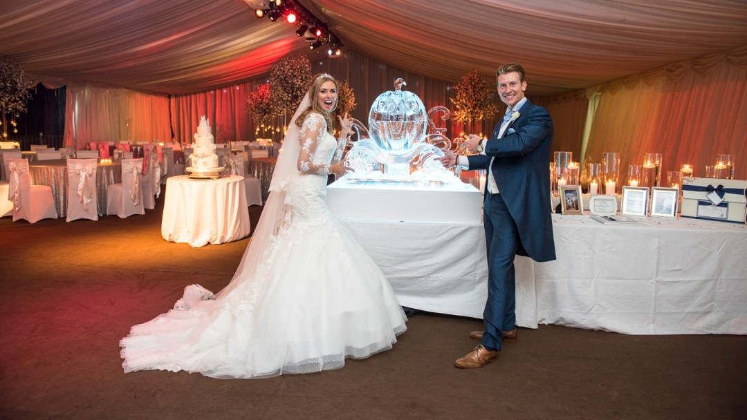 bride-and-groom-with-ice-sculpture