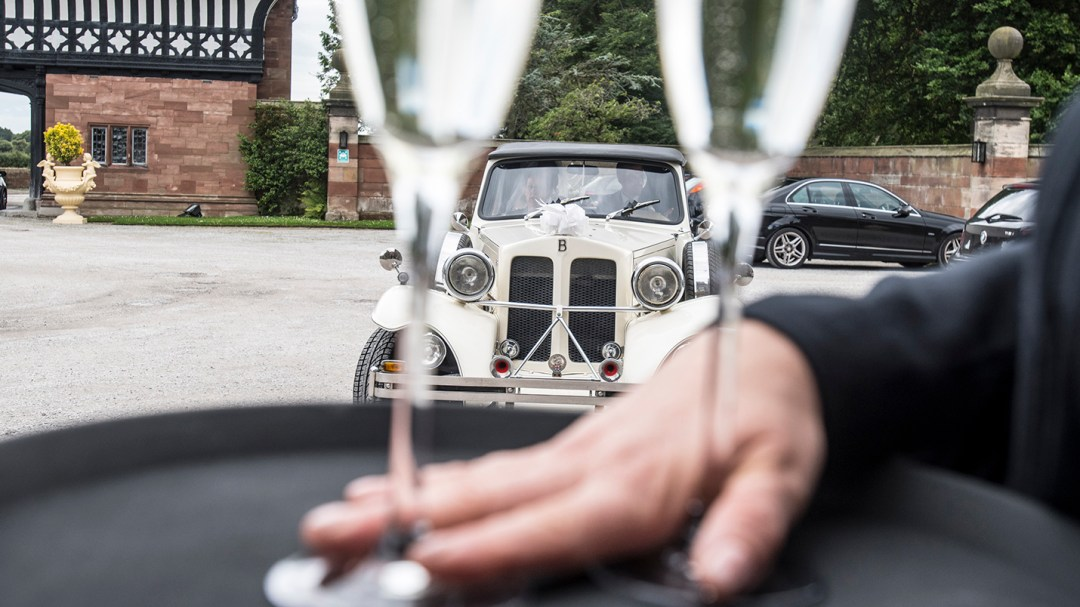Champagne on tray fro bride and groom as they arrive at Thornton Manor