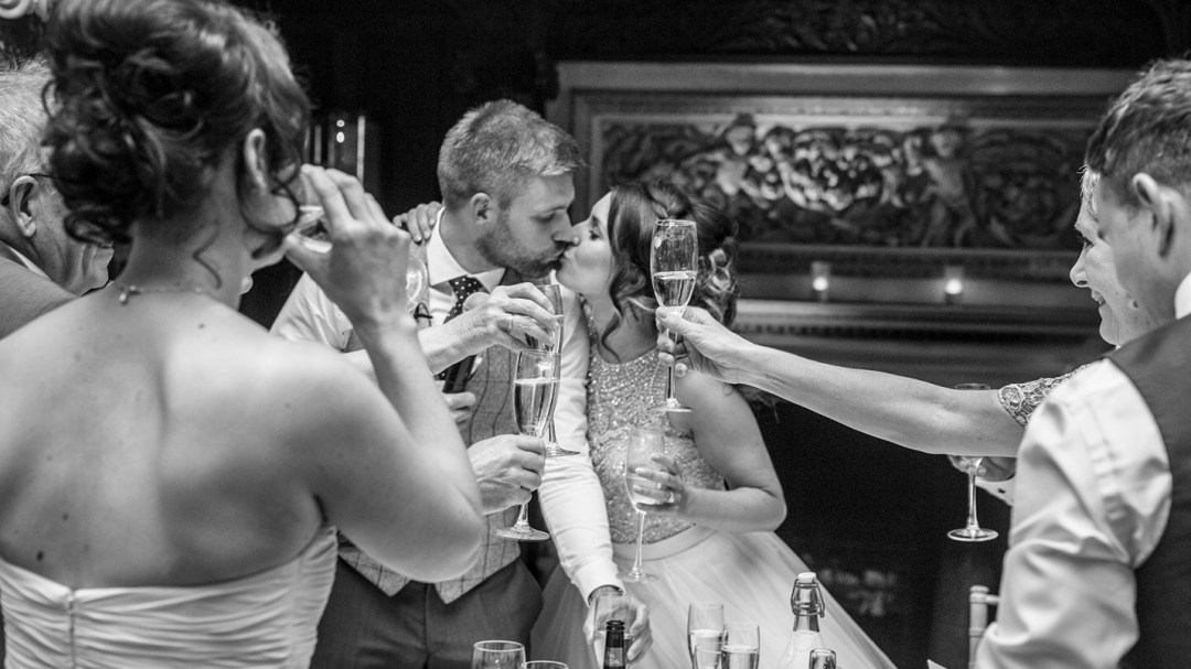 Toast to bride and groom with kiss