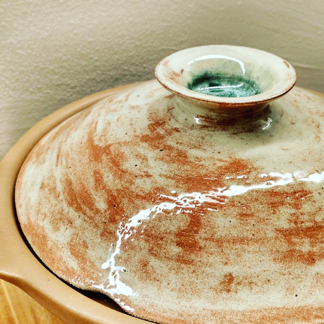 """A few weeks ago we broke the glass lid of our crock pot. The shock of seeing the glass fall and shatter all over the kitchen floor was followed by the palpable guilt of """"I messed up big time..."""". But then we remembered that we are potters, and potters make pots.  So the glass lid is no more, and in its place is now a beautiful clay lid, one of its kind in this world. But more than a clay lid, it is a reminder that God has taken our old selves - what we had thought was beautiful enough - and broken it apart. And in our brokenness He has given us a new body that is beyond anything we could have dreamed of, so that we can truly rejoice in Him.  #studioasobi #broken #rebirth #rejoice #ceramics #madeinsingapore #lid #plate"""