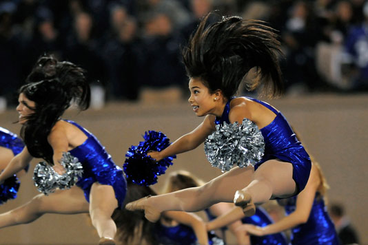 Air Force Academy dance team member Regina Loucks gets some air during the half time performance at Falcon Stadium in Colorado Springs, CO, USAF v San Diego State University football game, October 13, 2011. (AF Photo/Liz Copan)
