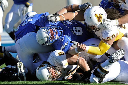 Falcons offensive lineman Jeff Benson finds himself towards the bottom of the pile during the second quarter of the USAFA vs. Wyoming game, November 12, 2011 at Falcon Stadium, Colorado Springs, CO. (U.S. Air Force photo/Liz Copan)
