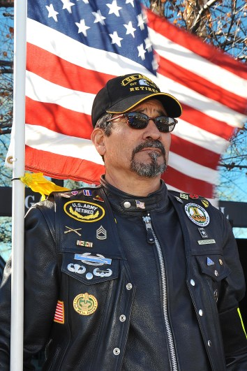 Patriot Guard Rider Daniel Cisneros holds a flag as the casket of Capt. Ryan P. Hall arrives at the Shrine of Remembrance in Colorado Springs, CO on March 9th, 2012. Members of The Patriot Guard Riders escorted the body of Capt. Hall from Peterson Air Force Base to the Shrine of Remembrance. Capt. Hall died Feb. 18th, 2012 when his U-28A was involved in an accident near Camp Lemonnier, Djibouti, located in the Horn of Africa. (US Air Force Photo/Liz Copan)