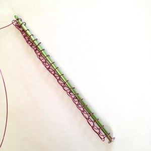 "9"" Tunisian Crochet Hook packed with 20 stitches of wire crochet work."
