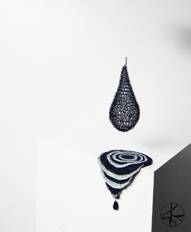 Dali inspired wire crochet water drop design with dripping water puddle