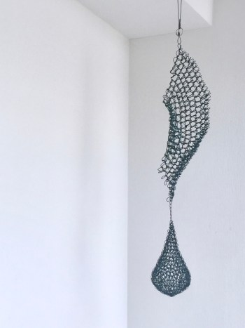 Wire Crocheted abstract waterfall decor culminating in a water drop