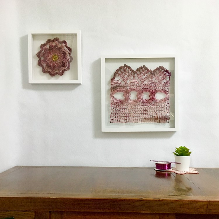 Two wire and fiber crocheted artworks, box framed in white