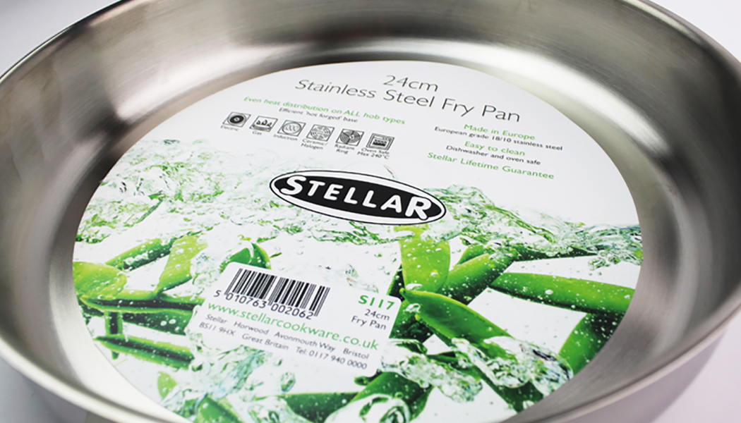 Close-up of Stellar stainless steel frying pan including label design