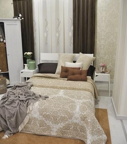 Exposición de cama para exponer ropa de hogar