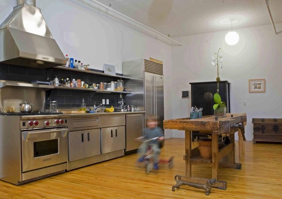 soho new york loft :: minimalist industrial kitchen w/room to ride ... minmal stainless steel kitchen with antique carpenter's workbench