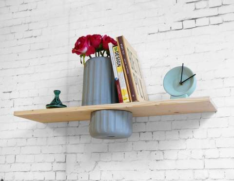 The vase-shelf. A wall mount shelf with a vase cut in half. The bottom part functions as a drawer