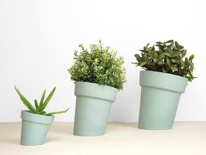 Distorted flowerpots in three sizes and three colors available.