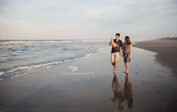 family photography of couple and baby walking on the beach in Corolla NC