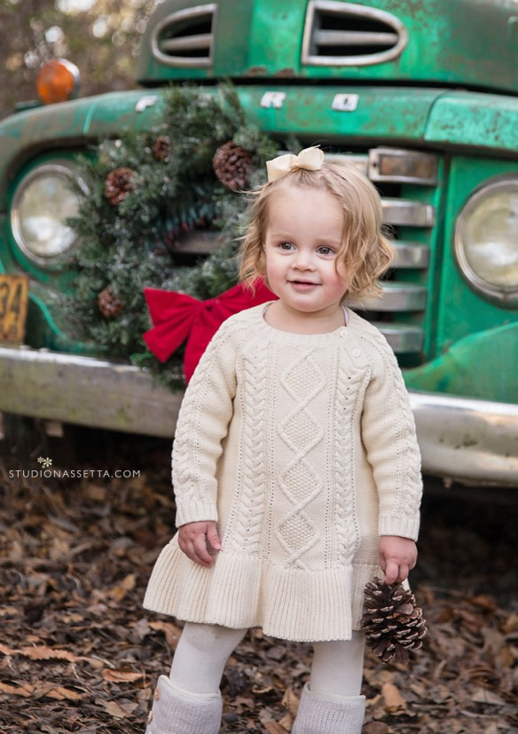 christmas photo of beautiful girlby vintage ford truck in nagshead woods North Carolina