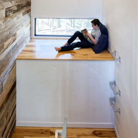 child reading in loft space