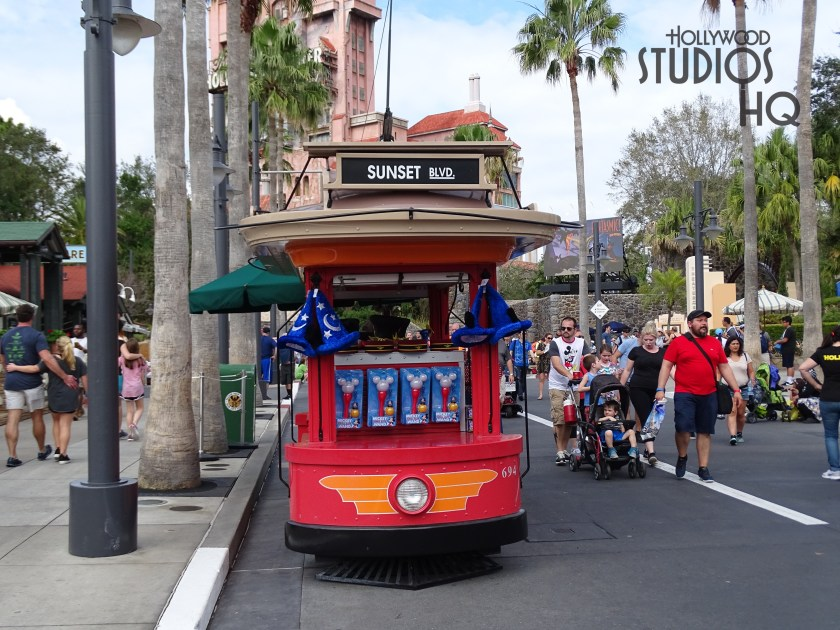 Moving on to Sunset Blvd, an old friend awaits guests. The old red trolley car of the past that had been located on Sunset Blvd from 2011 to 2014 has made its return. The trolley welcomes back guests with an assortment of hats, popcorn, soda and other treats.