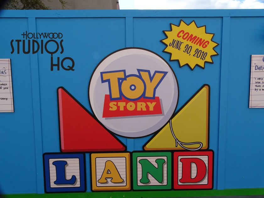 Disney's recent announcement of this attraction's June 30 opening date is emblazoned on two new signs forming stars that guests will now see on the Toy Story Land construction wall. In fact, just face the wall and walk backwards all the way to the face paint station for the best view of a new tower top residing in the magical land of Andy's toys. The view is even more evident at night due to spotlights behind construction walls inside the land. Check out the one of a kind photos and video below for the latest scoop.