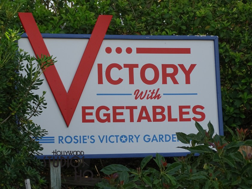 That's right, the Rosie's Victory Garden lies often unnoticed hidden next to Catalina Eddie' s on the heavily guest traveled Sunset Blvd. eatery . An awesome live garden including samples of kale, beans, peppers, cabbage, rosemary and mint which is close to its owner's restaurant, Rosie's American Café. Why, there are even garden tools attached to the side of the building. Named after Rosie the Riveter from the women working in factories during WW II, this treasure brings a part of cultural history to the Studios. Feel free to view below, but please don't pick the vegetables.