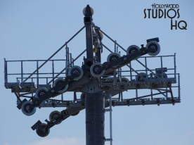 A second metal lift tower post to support the new future gondola system haul cable has been installed in the middle of the Music guest parking area at Disney's Hollywood Studios. New today to report is the overnight magic that placed the top guide & cabling mechanism onto this second tall structure. Brand new photos below tell the story at Disney's Hollywood Studios. Photo by John Capos