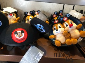 Relocated from prior displays in Mickeys of Hollywood, a variety of 2018 themed apparel, accessories, toys, and holiday decorations now await summer guest crowds. Children and adult clothing, beach towels, toy trucks, and select plush are all located in the Carthay Circle middle merchandise area. Shoppers looking to add to their Christmas decor will find a choice of tree ornaments. Holiday ornament featuring either Mickey and Pluto or Chip and Dale can be purchased. Also, adult size 2018 Mickey ears come with either a Chip or a Dale character plush included. Disney's Hollywood Studios. Photo by John Capos