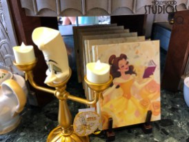 A contemporary Belle image is now portrayed on select new merchandise on display at the Carthay Circle. Shoppers will want to definitely see the new array of products that include the beautiful Belle image featured on teapots, a journal book, nifty carry bag, a women's shirt with matching fashion scarf, as well as an attractive Lumiere figurine for office or home. Belle has even included the choice of a Chip or adventurous and brave tea cup to enjoy one's favorite hot beverage. Disney's Hollywood Studios. Photo by John Capos