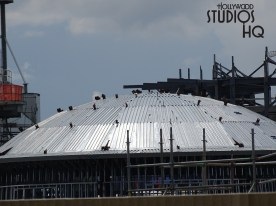 Brand new construction photos below reveal various views of this ongoing project. A mountain range and other rock formations are visible, along with various metal structures and framing. A distinct large circular roof structure and planet terrain peaks projecting skyward can be seen. Star Wars: Galaxy's Edge. Disney's Hollywood Studios. Photo by John Capos