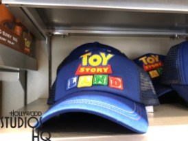 While the new Toy Story Land hosts two themed merchandise stands, these products actually are available to shoppers at multiple locations throughout the Park. The two main locations for shoppers are the In Character store located in Animation Courtyard and the brand new Beverly Sunset Boutique on Sunset Blvd. Exciting themed items include the popular Slinky Dog head band as well as an illuminated Slinky Dog toy with colorful middle section lighting. Guests can also select a Launching Slinky Dog Dash Attraction Vehicle play set with spinning flames. Toy Story Land fan merchandise include an illustrated themed drinking glass, book bag, autograph book, assorted trading pins, as well as a colorful commemorative coffee mug for home or office featuring the Land's opening date. Special offers on the store shelves reserved for Disney Passholders include an exclusive Toy Story Land string shoulder bag and a must have collectable pin. Apparel shopper offerings include a Toy Story Land red tee shirt complete with the Park opening announcement as well as a blue attraction logo cap. Young guests will delight at their own Alien Claw tee shirt and even infant wear is available featuring Jesse and friends. An attractive women's blue themed tank top is ready for summer time comfort. Don't forget to pick up the novel illuminated Alien head band or the Alien lighted tall glass to enjoy during evening Park activity. Toy Story Land merchandise would not be complete without a unique helium balloon featuring Buzz Lightyear, Woody, Jesse, and Bullseye. Disney's Hollywood Studios. Photo by John Capos