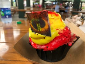 Guests can enjoy a tempting red velvet cupcake complete with delicious cream cheese butter cream icing at two Sunset Ranch market quick service locations. Both Rosie's All-American Cafe and Catalina Eddie's have added this dessert to their menu. The yellow and red Incredibles 2 theme colors adorn this treat which is complete with a chocolate logo. Disney's Hollywood Studios. Photo by John Capos