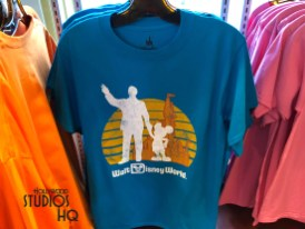 """Keystone Clothiers offer guests a new array of graphic tee shirt apparel for adults. Shoppers can select from a light blue retro Walt Disney World logo shirt featuring beloved Walt and Mickey. Lion King fans can display images of Timon and Pumbaa on a dark blue tee shirt. Likewise, a grey Sebastian image tee conveys the bold message: """"The Human World is a Mess"""". Guests in search of coordinated couple's tops can purchase black and white colored tees lettered with """"Power"""" on the man's and """"Couple"""" on the woman's. A Mickey tee shirt is available with the Mouse proclaiming:"""" I don't do matching shirts"""". Additional apparel selections on Keystone Clothiers racks include a novel slogan tee """"I'll do it Tomorrowland """", in addition to brightly colored Nike men's golf shirts complete with an arm sleeve Mickey image. Disney's Hollywood Studios. Photo by John Capos"""
