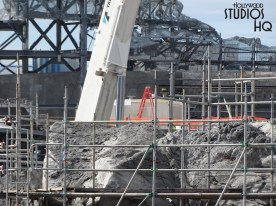 Accelerated efforts by workers have completed the rock surface on numerous mountains and peaks. Fresh photos reveal that scaffolding has been removed in many locations with the completion of the authentic mountainous terrain surfaces. A stunning temple circular dome has been completed. Likewise, the first ship is now visible behind construction walls which is identical to the craft guests see when visiting Batuu in the Star Tours attractions. Keep watching Hollywood Studios HQ for more of the latest developments. Star Wars: Galaxy's Edge. Disney's Hollywood Studios. Photo by John Capos
