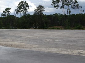 Construction activity continues on the Park's future main entrance roadway as well as in additional vehicle parking areas. As evident in the brand new photos below, the future ticket plaza is undergoing painting while access roadway leading from Osceola Parkway has been paved. Crews continue to complete their work on a broad expanse of new paved parking spaces yet to be opened. For guests traveling by Disney resort buses, temporary arrival and departure continues from the newly opened charter bus pick up area. Large shade umbrellas are present in the temporary resort bus cues to help comfort waiting riders. Meanwhile, photos below depict the ongoing work to complete the permanent resort bus guest loading and unloading cues while other crews are finalizing the demolition of the original resort bus arrival and departure locations. Disney's Hollywood Studios. Photo by John Capos