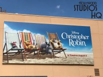 Giant billboards behind the Chinese Theatre announcing the Christopher Robin motion picture with lovable Winnie the Pooh and friends, along with the release of A Wrinkle In Time movie on blu-ray. Disney's Hollywood Studios. Photo by John Capos