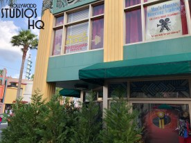 The popular Reel Vogue store has a refurbished exterior. Crew's finished this week applying a fresh coat of forest green paint to the structure. This location offering Pixar and other themed merchandise remained open for shoppers during the refurbishment. Disney's Hollywood Studios. Photo by John Capos