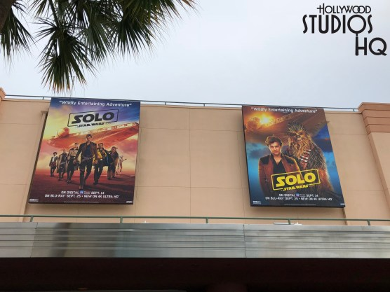 Two new giant billboards overlooking the Park's Animation Courtyard announce upcoming media release dates for the motion picture Solo: A Star Wars Story. Beginning September 14, 2018, fans can purchase the digital version. The Blu-Ray release date places this film version on store shelves beginning September 25, 2018. Smaller corresponding lamp post banners previous announcing the film's debut in theatres have been tagged with the updated digital and Blu-Ray release dates. Photo by John Capos
