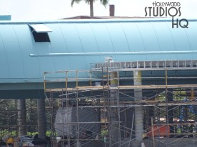 Construction crews continue a steady pace of work on the Park's Skyliner loading and unloading station as pictured below. Additional yellow wall sheeting is being installed. A new red colored gondola vehicle wrapped in a protective cover has been positioned on a platform. Stay tuned to Hollywood Studios HQ for the latest news on this future guest transportation system. Disney's Hollywood Studios. Photo by John Capos