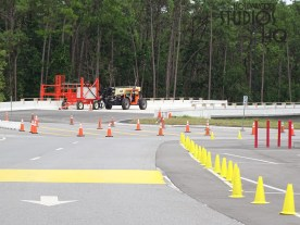 Construction crews are placing the finishing touches on the Park's new vehicle parking ticket plaza. New signage including the Park's name in large red lettering and operating hours signs for each vehicle lane at attendant booths are now in place. As pictured below, all vehicle lanes are paved and the canal bridge connecting the new main entrance to guest parking areas appears ready for traffic. Disney's Hollywood Studios. Photo by John Capos