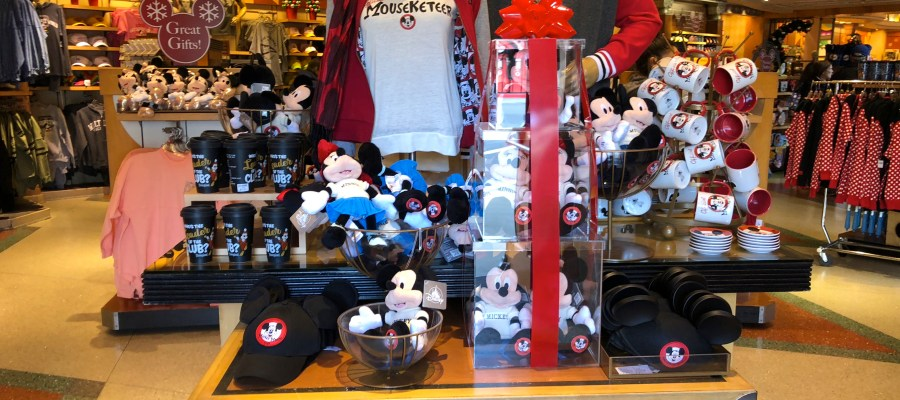 Guests can select from an array of Mickey Mouse Club apparel, mugs, plush, and other items at Mickey's of Hollywood. This Mouseketeer merchandise selection offers great holiday ideas that will make perfect gifts for adults and children. Themed tee shirts, jackets, socks and Mouse ear ball caps await shoppers. Colorful Club themed throws, plush characters, saucers, and mugs are also on display. Disney's Hollywood Studios. Photo by John Capos