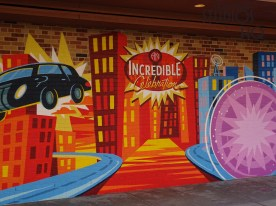 """Park guests can now enjoy the new An Incredible Celebration located in the former Pixar Place. This new Incredibles themed area, called Municiberg, is open 10:30am to 6:30pm daily. The Edna Mode Experience provides a meet and greet opportunity with super suit designer Edna Mode herself. Guests also join Mr. Incredible, Mrs. Incredible, and Frozone for a continuous dance party of music and games at the end of the block. The Neighborhood Bakery will delight hungry guests with menu selections including an Incredible Hero Sandwich along with pretzels, cookies, and beverages. Special straws are available. The gift area offers """"Incredibles 2"""" merchandise. Disney's Hollywood Studios. Photo by John Capos"""