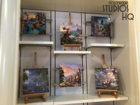 A colorful painting collection featuring Disney characters and classic movie scenes awaits shoppers at the Stage 1 Company Store on Grand Avenue. An additional selection of color Disney drawings and unique figurines are also available. Park merchandise news is always awaiting readers on Hollywood Studios HQ. Disney's Hollywood Studios. Photo by John Capos