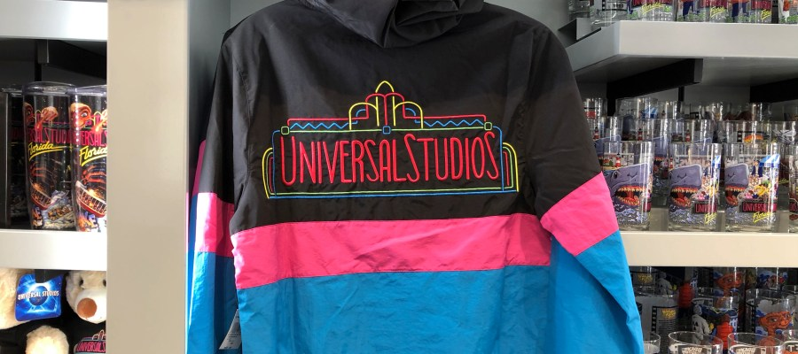 A new addition to Universal's retro merchandise selection is a multi colored adult wind breaker jacket. Shoppers will find this apparel inside stores throughout the Park. Subscribe now to Hollywood Studios HQ for the latest merchandise updates. Universal Orlando. Photo by John Capos