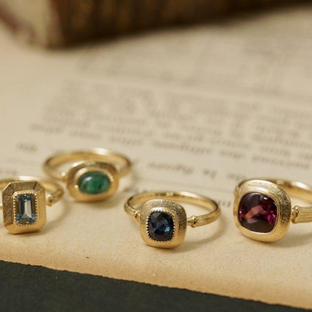 K18/ Aquamarine, Emerald, Sapphire, Garnet