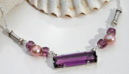 Margarita,A sterling silver necklace with early 1900's long rectangular amethyst glass set in lost wax cast sterling accented with vintage Czech glass roundels and genuine pink pearl