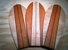 Mike Lynch, 3 surfboard style cutting boards in curly maple and cherry.