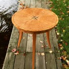 Mike Lynch, A starburst cherry round table with an inlaid compass star